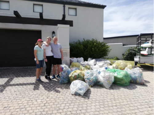 Project18 Team with Green Solutions standing next to all rubbish cleaned up.